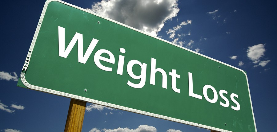 Weight Loss Road Sign on dramatic blue sky and clouds background.